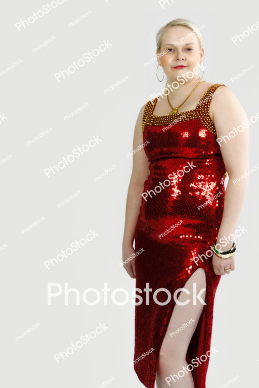 Woman posing in red sequined dress