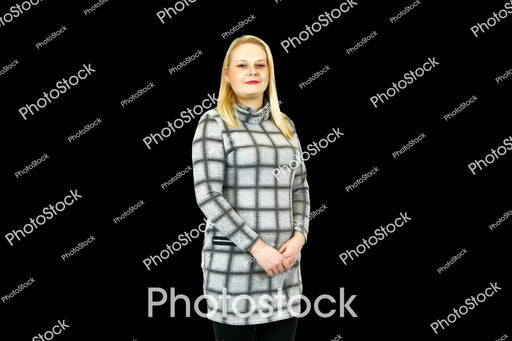 Seated woman in grey check high neck dress