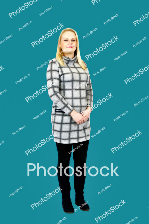 Woman posing in grey checked top