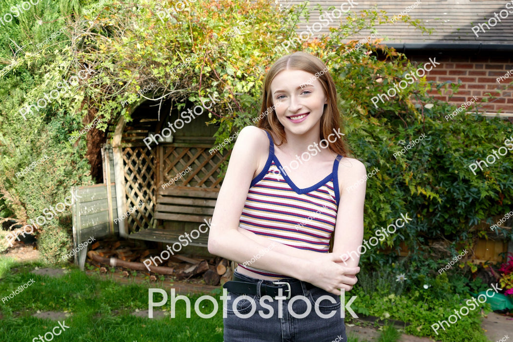 Young woman posing in back garden