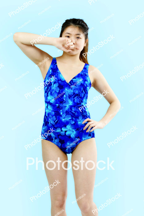 Young woman posing in floral blue swimsuit