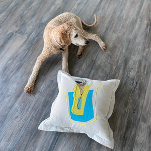 large linen pillow on floor with dog