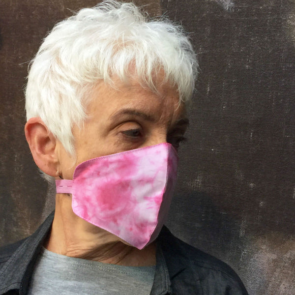 Woman wearinng Breast Cancer Awareness Limited Edition Pink Tie-Dyed Mask.   50% of profits goes to The Pink Funds Real Help Now Fund.   Because fabric is hand-dyed, colors do vary.