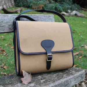 Berkeley Canvas and Leather Laptop Bag outside on bench