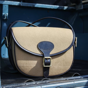 Canvas and leather cartridge bag in Land Rover Defender