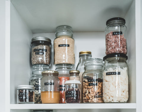 Mason Jars filled with food in pantry