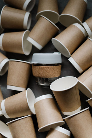 Paper Coffee Cups surrounds Eco Friendly Reusable Coffee Cup