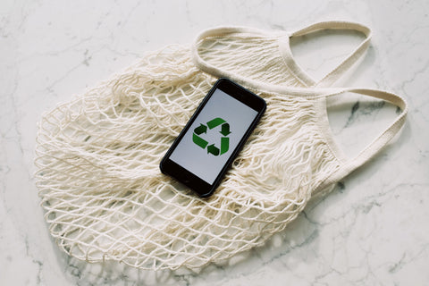 Recycle Icon on phone on Market Bag