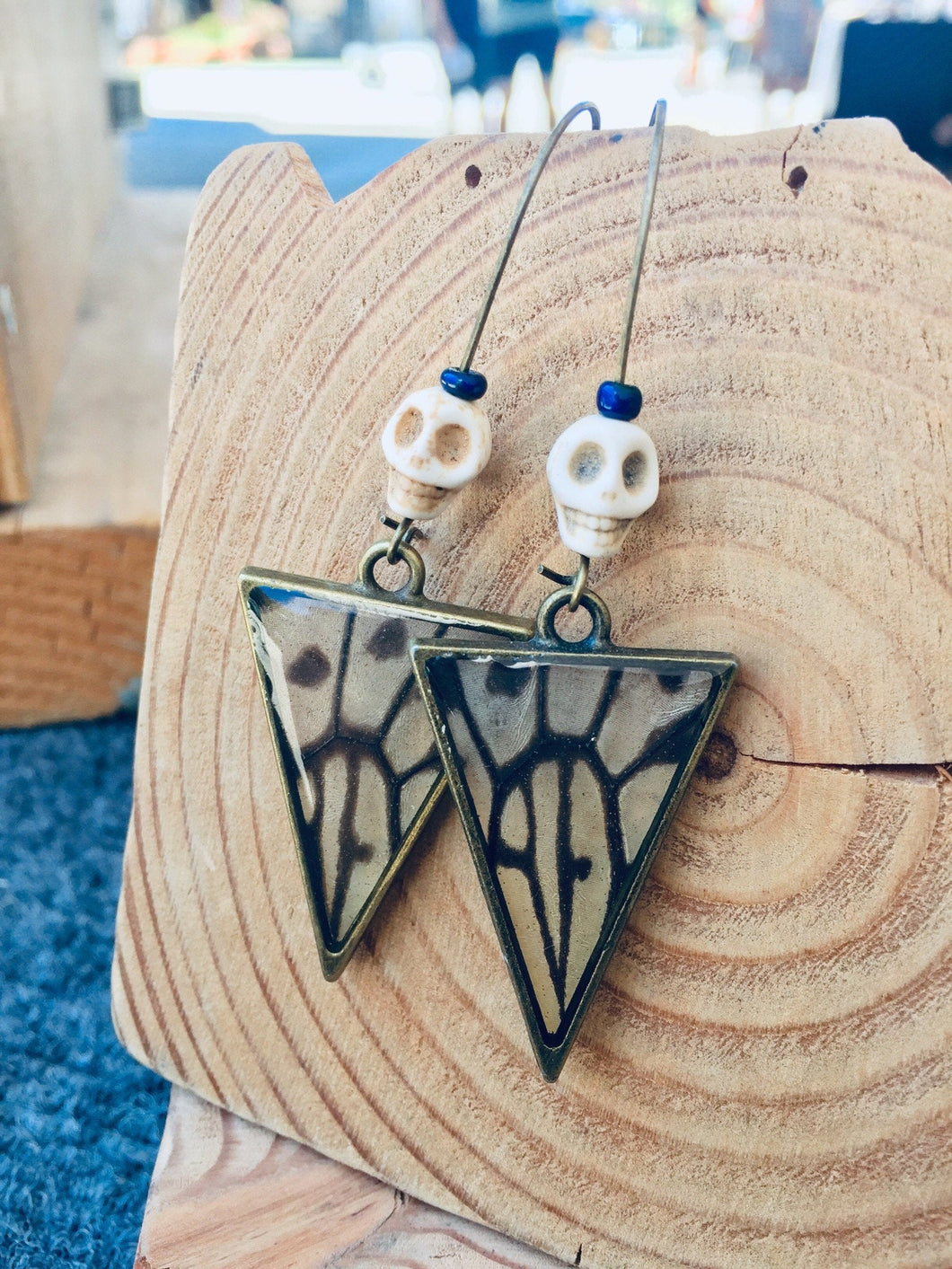 Clear Butterfly Wing Skull Earrings
