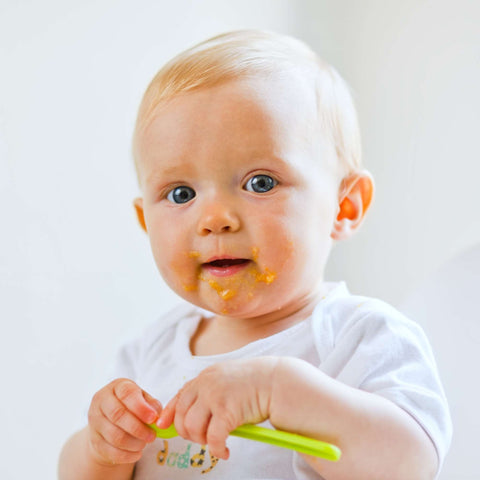a little human, with food all over it face