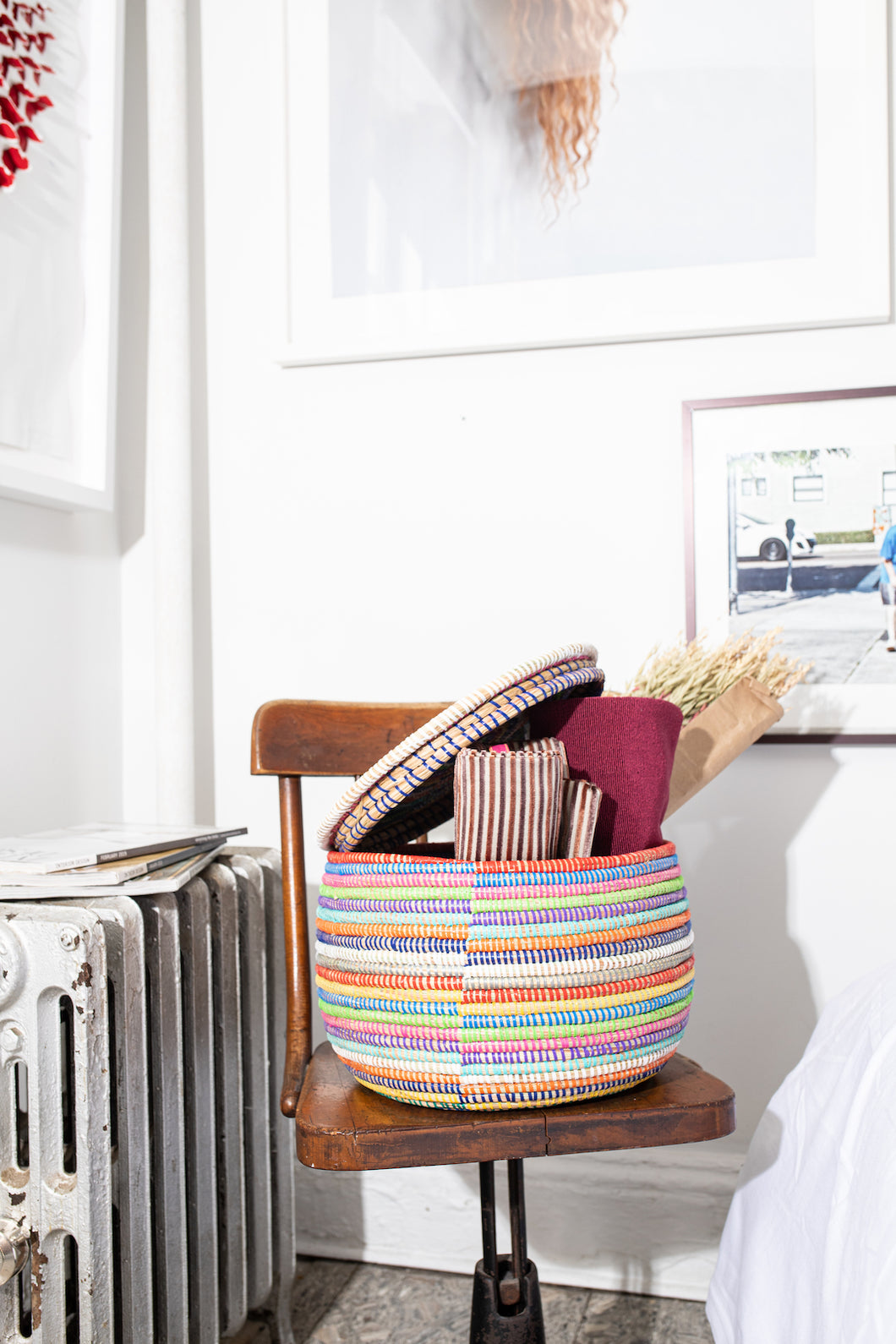 Rainbow striped lidded warming basket. They can be used for storing knicks knacks, decor for a shelving or even keeping baked goods warm.