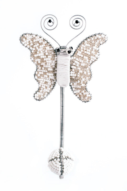 These hand beaded flower and butterfly wall hooks were made in South Africa's KwaZulu-Natal province. Traditional beading techniques are used with a fun and modern twist.  These whimsical hooks are eco-friendly and fairly traded.  They are great addition to a nursery, daycare or something special for a big girl's room!