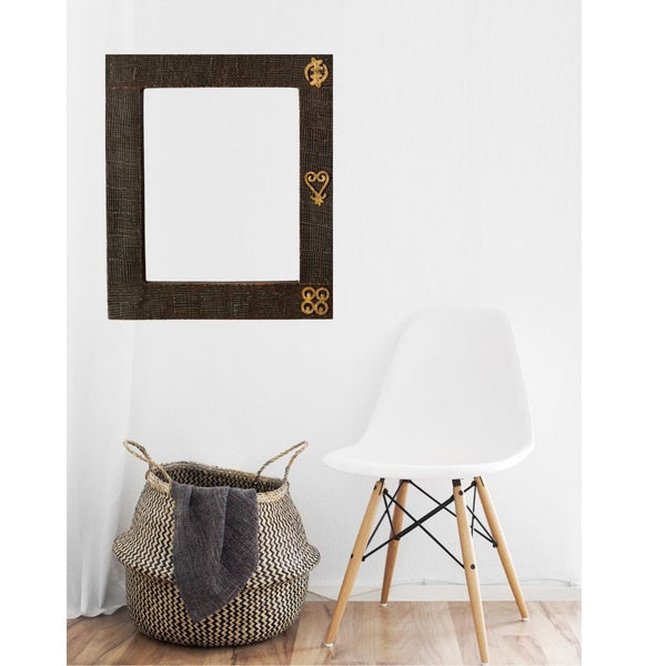 This stylish wooden mirror made by Ghanaian artisans add a textured finish and dark stain features to your space.