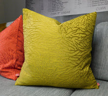 Load image into Gallery viewer, citrine pillow with vines texture, coral matching pillow behind it on gray BoConcept sofa with oversized cuba boxing canvas behind it.