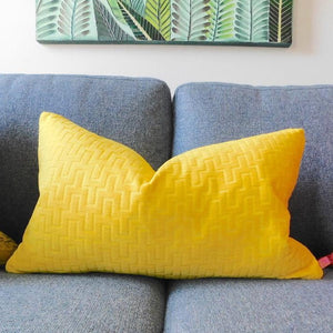 Geometric textured chenille in vibrant yellow on  sofa in guest room in new  jersey townhouse