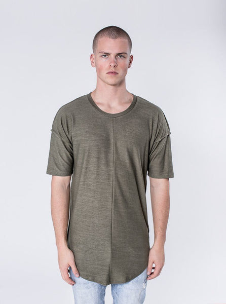KOLLAR CLOTHING. Alber - Deep Olive This lightweight textured t-shirt is a tasteful addition to any outfit. The Alber has a scooped bottom hem and dropped shoulders. The shirt is packed with subtle details such as the inside-out raw edged seams and cut and sew detailing. This fabric is a custom knit, which has been created with comfortability in mind.