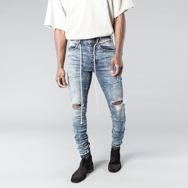 THE BLOWN OUT DENIM IS THE PERFECT FITTING DENIM WITH HEAVILY DISTRESSED KNEE DETAILING. OTHER AREAS WITH DISTRESSING ARE THE FRONT/BACK POCKETS AND CUFFS. THIS STYLE IS PACKED WITH DETAILS SUCH AS OUR SIGNATURE CUT AND SEW SEAT DETAIL, YKK ANKLE ZIPPER CLOSURE, PREMIUM BUTTON FLY AND HARDWARE. INCLUDES LACE BELT LOOP ACCESSORY.