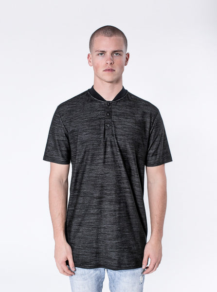 KOLLAR CLOTHING. Bloke - Charcoal This shirt is the perfect combination of formal and urban. The Bloke has a button down collar and an elongated rear. This shirt comes standard with the signature cut and sew back detailing. The Bloke is a staple as it can be dressed up or down.
