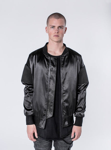 KOLLAR CLOTHING. Dilox - Black The Dilox is a mid-weight bomber jacket and is a subtle statement piece. Its design is very minimal, but includes a ribbed shoulder, ruched arm and custom interior placket.