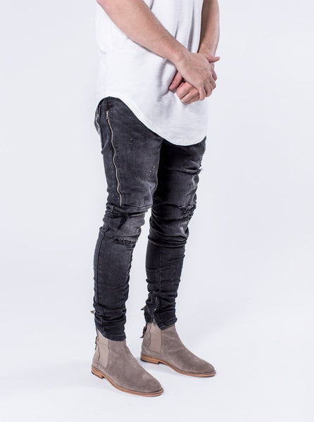 Dunlox - Faded Black The Dunlox is the perfect fitting denim with distressing, thigh YKK zipper detailing, distressed knees and YKK zipper ankle closure. These jeans come with our signature cut and sew seat detailing on the rear of the pants.