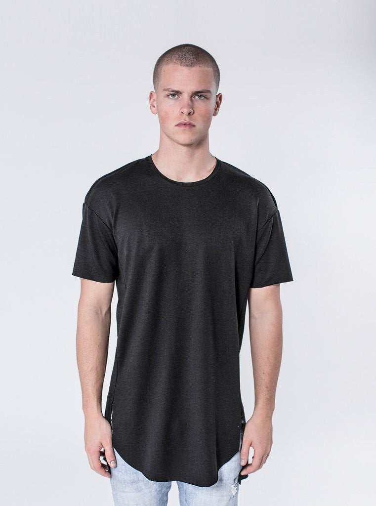 KOLLAR CLOTHING. Tilo - Black This lightweight  t-shirt is a unique piece that is needed for any stylish man. The Tilo has a scooped bottom hem and raw edge details. This shirt has a unique side panel construction that gives the shirt a new twist on a classic silhouette. This shirt comes with signature cut and sew detailing down the rear.