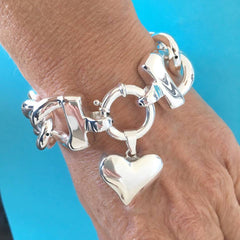 1 A Chunky Link Bracelet with forever Heart Charm..