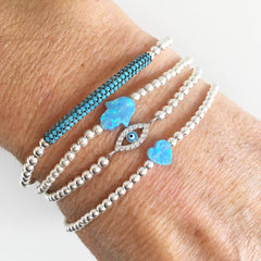 A Turquoise Bracelet with Sterling Silver Balls