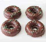 Food photography of four delicious peppermint and chocolate vegan doughnuts