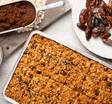 Food photography of golden flapjack and dates