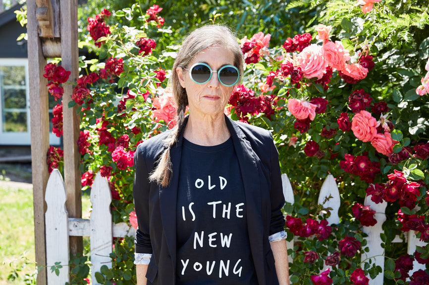 Hormones be Damned Image of an older woman wearing a tshirt that says old is the new young