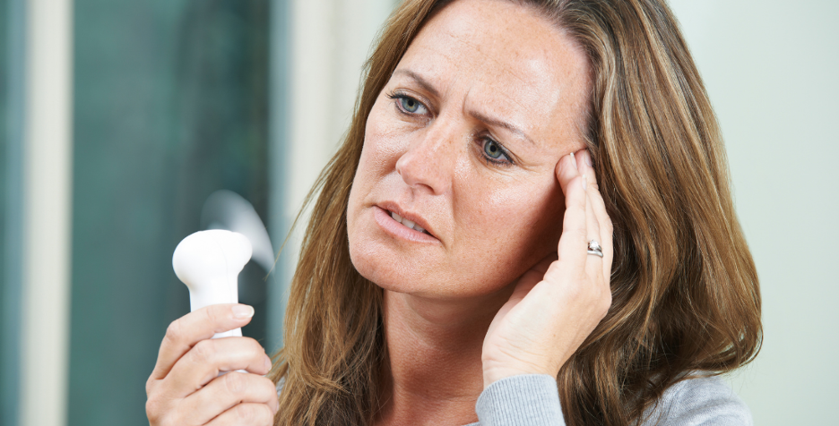 What is menopause, and what are the symptoms of it?