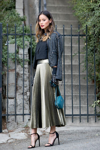 Jamie Chung Pleat skirt strap heels jacket layer outfit