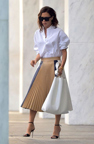 Victoria Beckham Pleated skirt neutrals with strap heels outfit