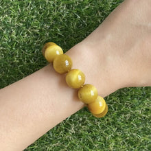 Load and play video in Gallery viewer, Gold Tiger's Eye 14mm Bracelet