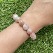 Load and play video in Gallery viewer, Cherry Blossom Tourmaline 10.5mm Bracelet