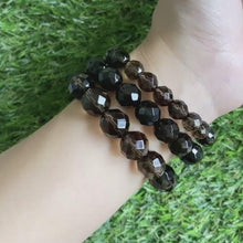 Load and play video in Gallery viewer, Smoky Quartz 12mm Faceted Bracelet