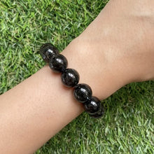 Load and play video in Gallery viewer, Nuummite 12.5mm Bracelet