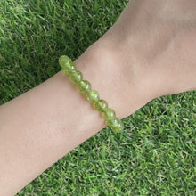 Load and play video in Gallery viewer, Peridot 7mm Bracelet