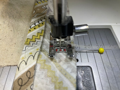 sewing bias tape to apron