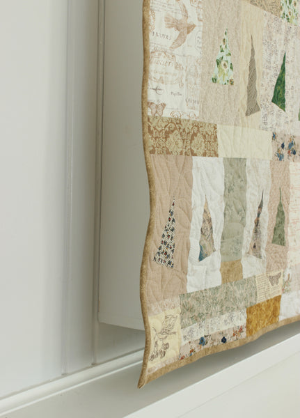 Side view of wall quilt covering TV