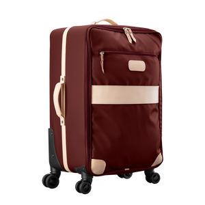 Large 360 wheeled luggage diagonal view in Color 'Burgundy Coated Canvas'