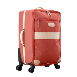 Large 360 wheeled luggage diagonal view in Color 'Coral Coated Canvas'