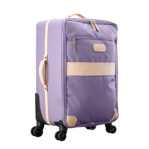 Large 360 wheeled luggage diagonal view in Color 'Lilac Coated Canvas'