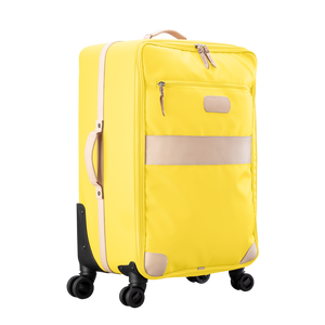 Large 360 wheeled luggage diagonal view in Color 'Lemon Coated Canvas'