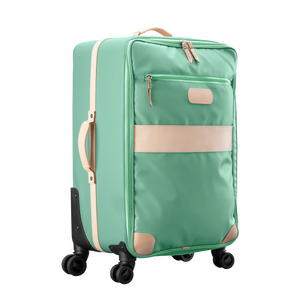 Large 360 wheeled luggage diagonal view in Color 'Mint Coated Canvas'