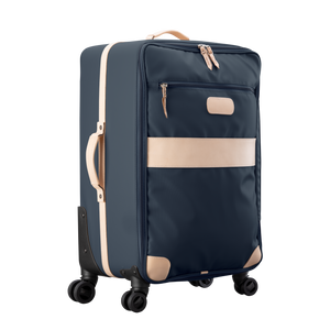 Large 360 wheeled luggage diagonal view in Color 'Navy Coated Canvas'