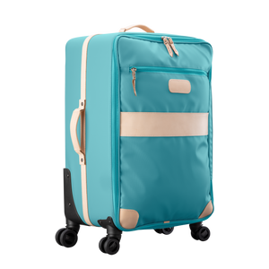 Large 360 wheeled luggage diagonal view in Color 'Ocean Blue Coated Canvas'