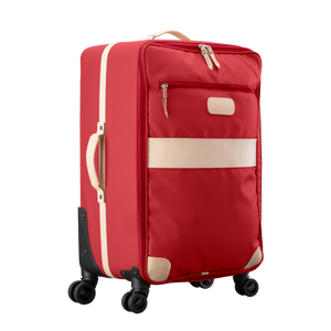 Large 360 wheeled luggage diagonal view in Color 'Red Coated Canvas'