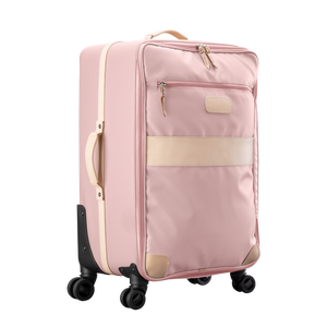 Large 360 wheeled luggage diagonal view in Color 'Rose Coated Canvas'