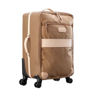 Large 360 wheeled luggage diagonal view in Color 'Saddle Coated Canvas'